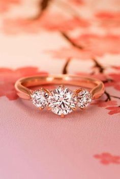 three stone engagement rings round cut rose gold
