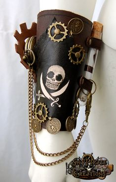 Steampunk Pirate Leather Bracer    Handmade leather bracer with a jolly roger, pocket watch, message bottle, coins and cogs.    Ties up with