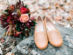 A sweet pair of bridal flats. PHOTOGRAPHER: Rachel May Photography STYLING/DECOR: Amore Events by Cody GOWN: Love Marley Rosalie FLOWERS: Southern Blooms VENUE: Great Falls, VA