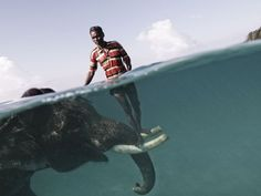 Nazroo, a mahout (elephant driver), poses for a portrait while taking his elephant, Rajan, out for a swim at Radha Nagar Beach in Havelock, Andaman Islands.
