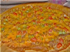 Chi-Chi s Mexican Pizza from Food.com:   								This is my clone version of Chi-Chi's original Mexican Pizza, before they changed the recipe and went out of business, lol.