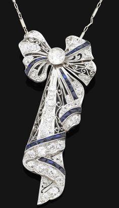 A Belle Epoque sapphire and diamond pendant/brooch, circa 1918