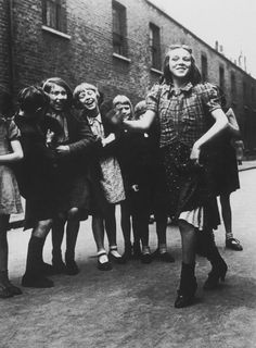 the lambeth walk, 1936  the girl lived in bethnal green, in the east end of london. at the photographer's request she is dancing the lambeth walk, a dance made famous in the 1930s. although dressed in an ill-fitting assortment of clothes, she performs with elegance and self-possession. photo by bill brandt, from the photography book; p. 67.