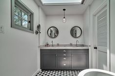 Seeing Double - 25 Celebrities With Next-Level Design Taste - Photos His And Hers Sinks, Circular Mirror, Skylight, Double Vanity, Bathrooms, Celebrities, Design, Photos, Home Decor