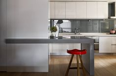 minimal kitchen i with white cabinets and gray accents. Renovation by Ganna Design Studio. http://design-milk.com/taiwanese-apartment-showcasing-toys-travel-souvenirs/