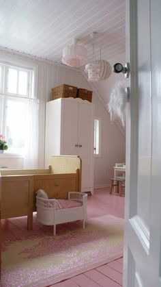 I was going to paint the little girls floors white but pink....hmmmm...