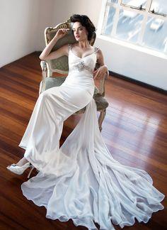 Elegant slender cut silk satin wedding dress detailed with Swarovski crystals and a long silk chiffon train. View dress.