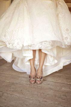 Gold shoes, raised wedding dress