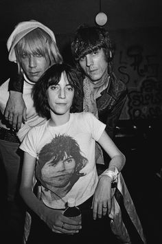 Patti Smith poses with Iggy Pop and James Williamson of The Stooges in November 1974 backstage at the Whisky a Go Go in Los Angeles California Black and white Photo by Michael Ochs