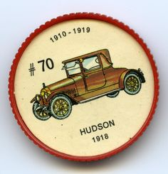 """Jello-O Coin 70 - Hudson (1918) - The two-seater Hudson """"Runabout Landau"""" was an early attempt at a convertible coupé with the appearance of a closed car. The """"Super-Six"""" engine, introduced the previous year, was the first with a fully balanced crankshaft. The split windshield was a favourite device for summer ventilation"""