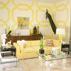 Yellow and white. I love the use of animals in the room! I have a fair number of white sculptures that will look just beautiful in my office!