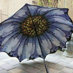 """Floral Flower Daisy Umbrella Parasol Cute! Umbrella w scalloped edges. Double layer. Outside layer is black. Inside has good quality photo print of daisy. Great for photo shoots, but also great for rain or sun. 34"""" long when closed. 41"""" canopy when open. 8 flexible fiberglass ribs will not break. Curved handle. Automatic open. Cane style umbrella. Accessories Umbrellas"""