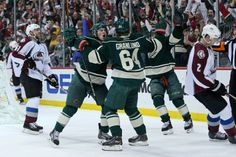 Apr 28, 2014; Saint Paul, MN, USA; Minnesota Wild forward Mikael Granlund (64) celebrates his goal with forward Zach Parise (11) during the first period against the Colorado Avalanche in game six of the first round of the 2014 Stanley Cup Playoffs at Xcel Energy Center. Mandatory Credit: Brace Hemmelgarn-USA TODAY Sports