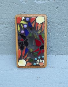Mosaic switchplate by PiecesofhomeMosaics on Etsy, $25.00
