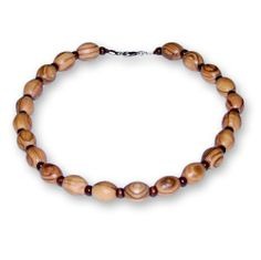 Handmade Olive Wood Short Beaded Necklace with Olive Wood Beads and Brown Wooden Beads From The Earth. $14.99. Handmade in Jordan. Supports Fair Trade. 46 cm (18 inches) long