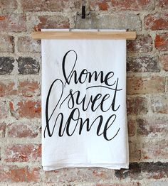 Home Sweet Home Dish Towel | With ornate calligraphy, this tea towel is a whimsical addition to your kitchen