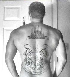 "'Gao Yord' Tattoo also known as ""9 Spires"". The preferred place for this tattoo is usually the back of the neck. It is for good luck and protection. Its geometric design represents the 9 Sacred Peaks of Mount Meru and contains 9 symbolic images associated with Buddha. The Tigers Tattoo below it is for protection from evil, giving its owner strength and courage."