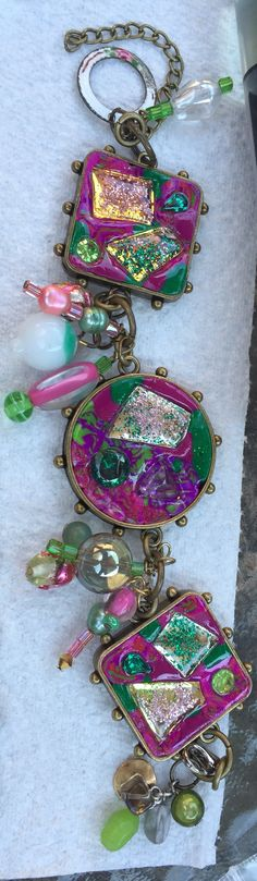 BIG bracelet using gemstones, polymer clay, dichroic glass, aluminum glitter and lots of beads.  Weighs a ton!