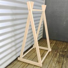 This clothing rack is perfect for baby clothing, you can hang onesies, and other cute outfits on it. You can sit it on top of a dresser or its