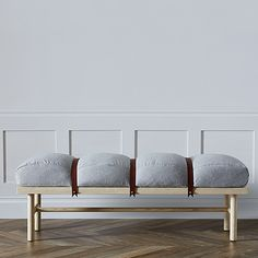 If you do the West Elm Mid Century bed with storage we could always do something like this bench to the headboard.  Like a custom fluffy pillow with a few leather straps secured with heavy duty brass snaps.