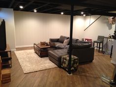Basement -painted ceiling panel wall and peel and stick vinyl floor Basement Guest Rooms, Man Cave Basement, Basement Windows, Basement House, Basement Plans, Basement Flooring, Vinyl Flooring, Basement Ideas, Basement Laundry