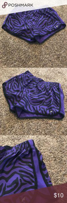 Purple zebra sport shorts Purple zebra sport shorts. Size small. Semi-Fitted. Version brand. Purple and black zebra print. Xersion Shorts