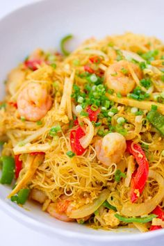 Singapore noodles are a Chinese-American rice noodle dish with shrimp, pork, vegetables and curry powder. Make this Chinese take-out favorite at home.