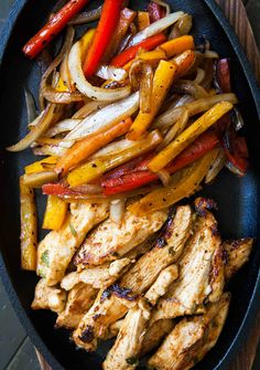 The BEST chicken fajitas! Marinated chicken breasts seared quickly and served with seared onions and bell peppers, and flour tortillas. On SimplyRecipes.com #fajitas #chicken #mexicanfood
