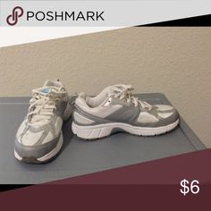 ✨Like New✨ White and Silver Nike Sneakers 💕Great Condition💕 Small stain on right show shown in pic 3 from normal wear and tear. Size Kids 3.5 which is EU 35.5 Nike Shoes Sneakers
