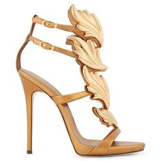 Giuseppe Zanotti has built a loyal following thanks to his fearless approach to design. These shoes certainly deliver: with bronze metal leaves climbing each foot and tall, slender heels, they perfectly capture his unique vision.