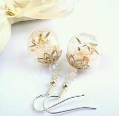 Dandelion seed hollow glass globe earrings with real gold and silver leaf.  Lovely delicate clear hollow glass bead earrings, which I have hand