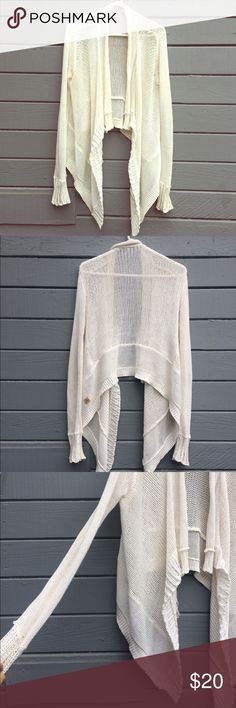 Rip Curl sweater Rip curl white seater cardigan. Open front. No closure. Light weight perfect transitional price for fall. Longer on the sides. Good condition. Rip Curl Sweaters Cardigans