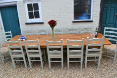 10 ft pine dining table with painted chairs