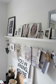 This is what I want above my desk. One picture ledge & one set of photo wires!