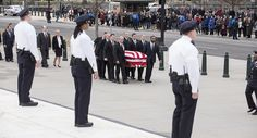 Enveloped in the American flag, Scalia's casket is carried by officers of the court serving as pallbearers. John Shinkle / POLITICO   Read more: http://www.politico.com/gallery/2016/02/photos-from-scalia-funeral-002204#ixzz40dz9hvsv