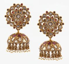 A PAIR OF DIAMOND AND RUBY 'JHUMKI' EAR PENDANTS.         Each designed as a hemisphere, kundan-set with table-cut 'polki' diamonds and rubies, suspending a fringe of seed pearls, to a similarly set openwork surmount designed as a flower head, with a total gemstone weight of approximately 11.00 carats, a total diamond weight of approximately 7.50 carats, and total pearl weight of approximately 4.00 grams, mounted in gold.