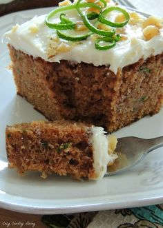 This moist and delicious Spiced Zucchini Cake is easy to make and serves a crowd!  If you've got zucchini, you've got to try this family favorite! #zucchini #cakes CozyCountryLiving.com
