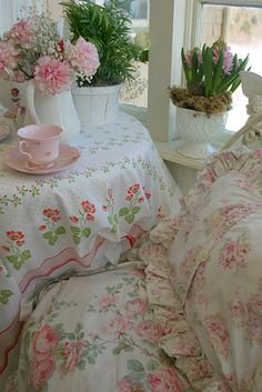 layers, ruffles, pillows, and flowers...makes for a cozy, cottage, sitting area