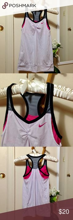 "NIKE Dri-Fit Bra Top Work-out Racerback Tank White w/ pink logo and pink built-in bra. Black lining on straps w/ gray, breathable material around the upper back. Has a bit of a stretch in the bra w/ 12% spandex. Shows a bit of wear w/ minor pilling here and there, but no flaws. What is Dri-Fit? Nike describes it as ""a high-performance, microfiber, polyester fabric that moves sweat away from the body and to the fabric surface, where it evaporates. As a result, Dri-FIT keeps athletes dry and…"