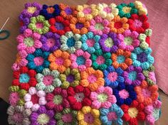 A beautiful pack of 20 Hand Made crochet flowers,used for appliques, for adding to throws, cushions or sewing together to make a cushion, ideal for crafters to use their imagination with.   BEAUTIFUL GIFT OR PERSONAL PROJECT - MADE TO ORDER  Approx size is 2.5 inches x 2.5 inches per flower, made in excellent quality wools.  If you have any requests for specific colours let me know.