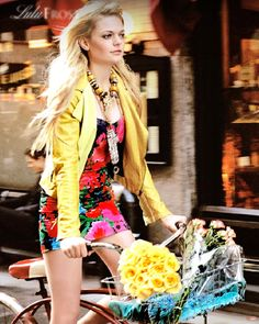 yellow jacket floral dress on bike