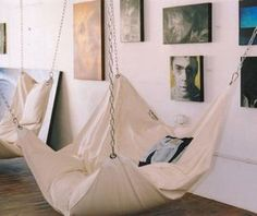 The Beanock Bean Bag Chair is a giant floating bean bag chair that looks and feels like a hammock, and kind of looks like a giant pillow being held up via chains on all four corners. The bean bag hamm...
