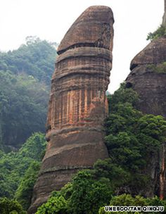 """Yangyuan stone on Danxia Mountain in Shaoguan, Guangdong Province. With the """"China danxia landform"""" added to the UNESCO' s World Heritage List at its meeting, making it China's property on the list. Danxia Landform, Yi King, Bizarre, Heritage Site, Natural Wonders, Wonders Of The World, Mother Nature, Amazing Art, Beautiful Places"""