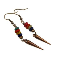 *  * Dangle earrings featuring colorful coco wood discs  * Copper tone spikes dangle beneath the coco wood  * Earrings are 2 inches long with copper tone brass earwires  * Designed and assembled by Ca
