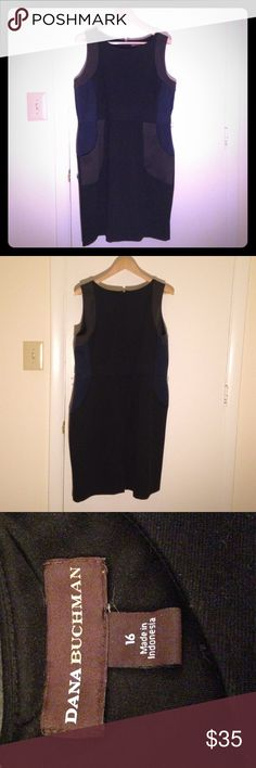 Dana Buchman - Cute professional dress (Size 16) This cute, professional color block dress will have you looking stylish at your next work meeting. Comes with an adorable black belt that will help cinch the waist. It is mostly black with some accents of blue and gray that help to accentuate an hourglass figure. Pair with a nice jacket and/or some jewelry to turn this sleek work dress into the perfect happy hour outfit. Dana Buchman Dresses Midi