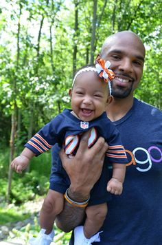 Chicago Bear Matt Forte holds his daughter like a football, and it's the cutest thing ever