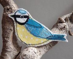 Blue Tit bird brooch. Machine freehand embroidery and appliqué. British garden bird.