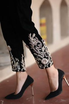 Classic and timeless, these black velvet trousers with pearl embroidery tops the list of this season's must haves. Pakistani Fashion Party Wear, Pakistani Dress Design, Pakistani Outfits, Black Pakistani Dress, Pakistani Bridal, Indian Outfits, Indian Fashion, Designer Wear, Designer Dresses