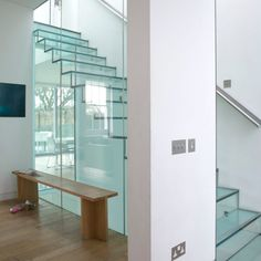 Glass staircase design brightens up home interiors, adding a beautiful architectural feature to modern homes and creating a striking focal point for interior design Interior Staircase, Modern Staircase, Staircase Design, Staircase Ideas, Contemporary Home Decor, Modern Interior Design, Contemporary Design, Home Design Store, House Design
