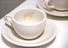 As you finish your coffee...the form of an endangered animal appears from the stain of the coffee or tea in the unglazed area....I'd like these to be available for purchase!